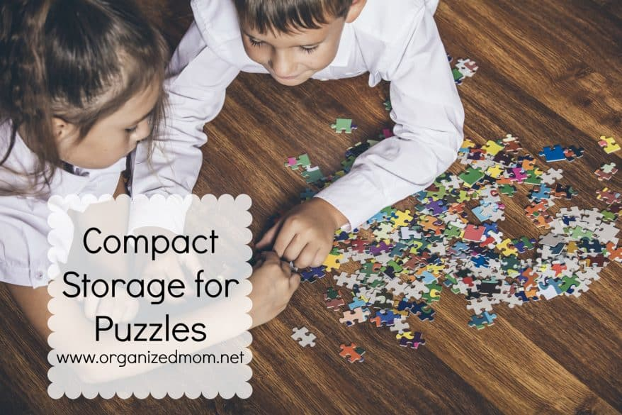 Happy boy and girl collect puzzle lying on the floor closeup