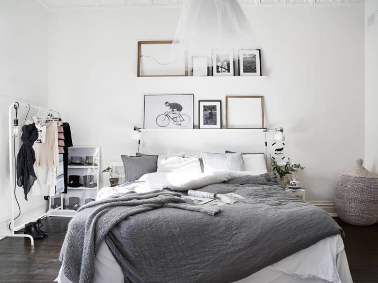 framed picture over bed