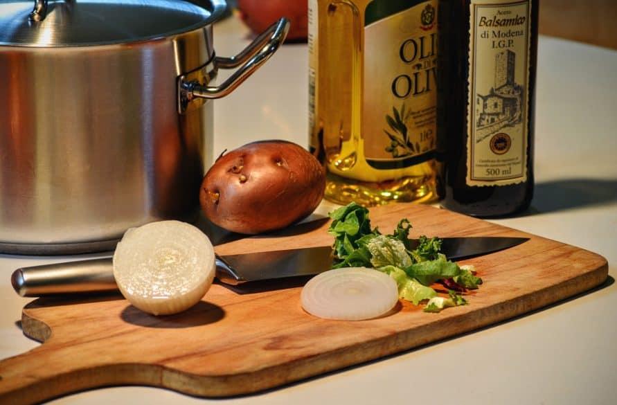 cutting onions on wooden cutting board