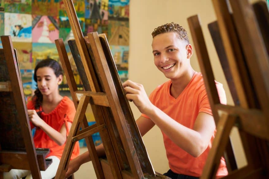 teen boy painting
