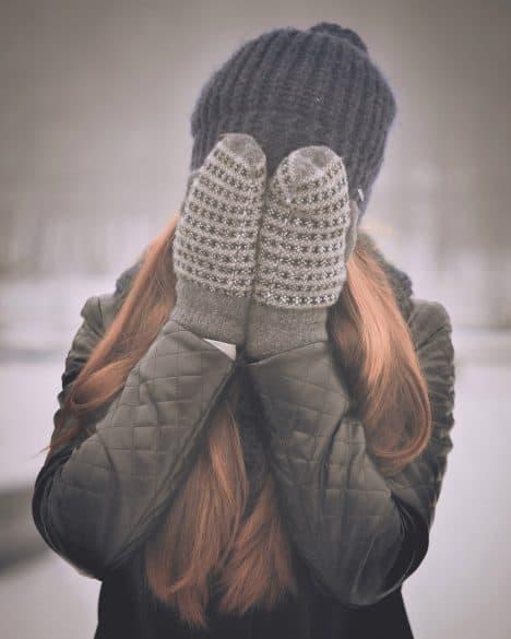 girl wearing mittens