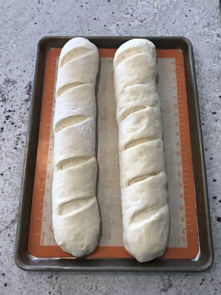 Two loaves of french bread ready for the oven.