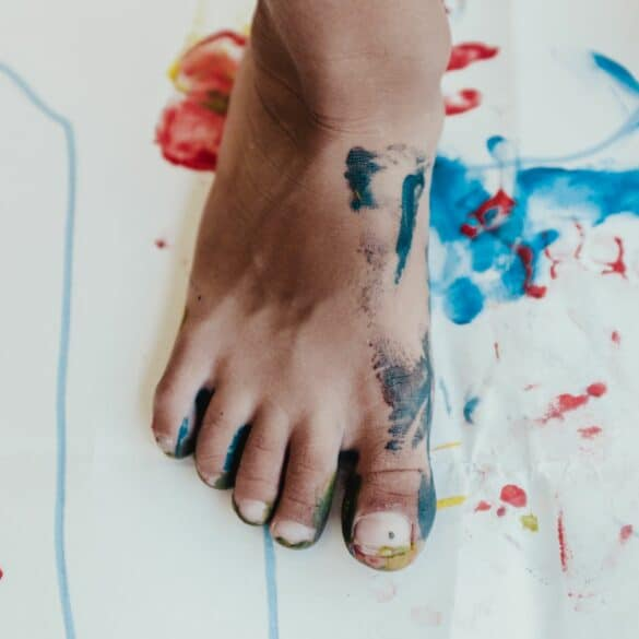 child's foot covered in paint; preschool education options