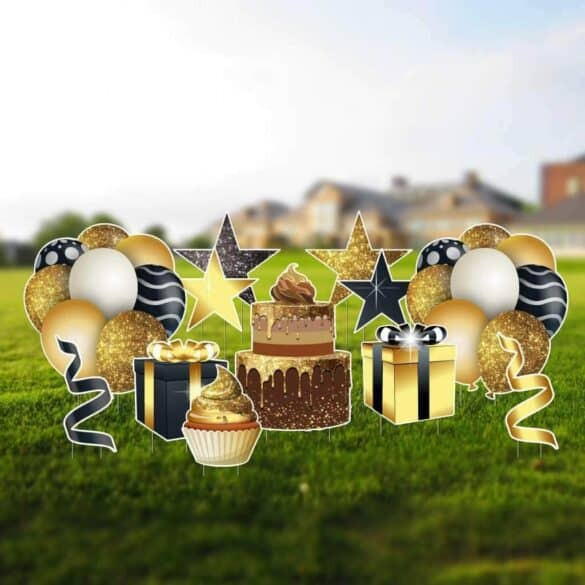 Yard signs that are gold, black and white in color and are the shapes of balloons, presents, stars, cake and cupcakes.