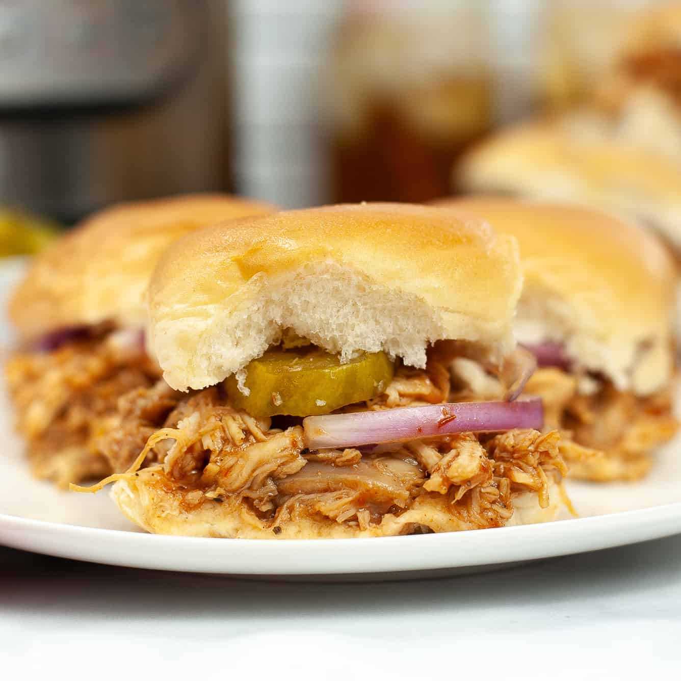 bbq chicken sliders with pickles and onion