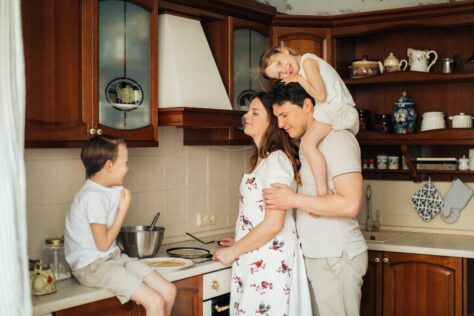 Family-make-dinner how to clean kitchen cabinets