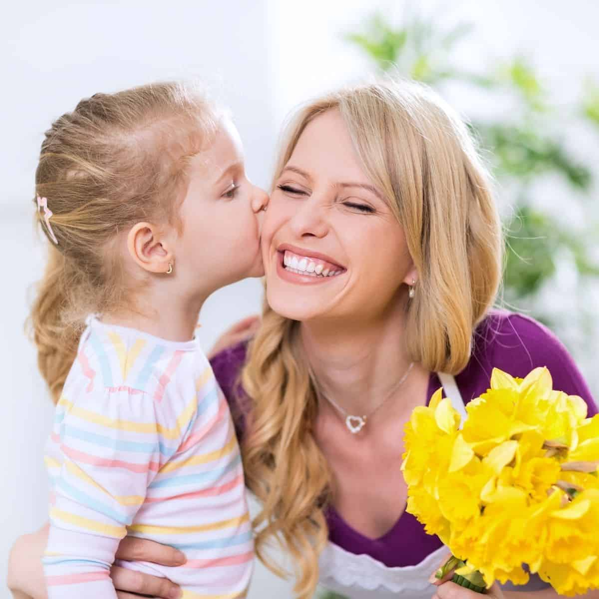 mother and child on mother's day with flowers