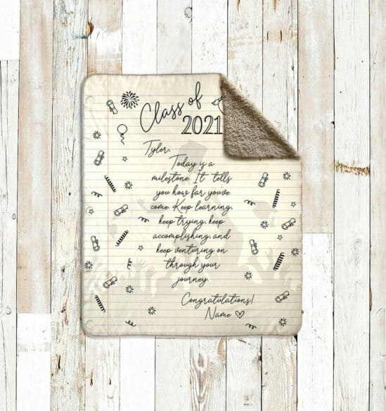 A cream blanket that looks like a piece of lined paper with a personalized message on it.