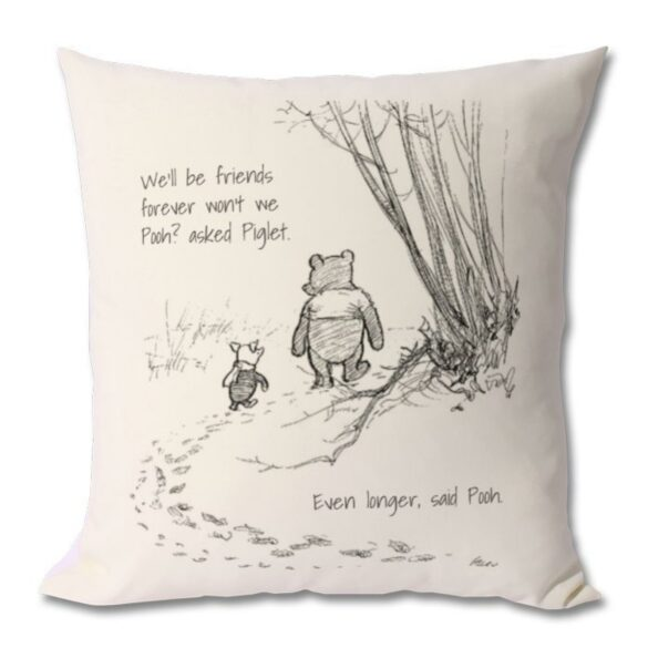 A pillow with a scene from Winnie the Pooh and a quote.