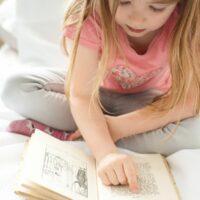 girl reading in summer