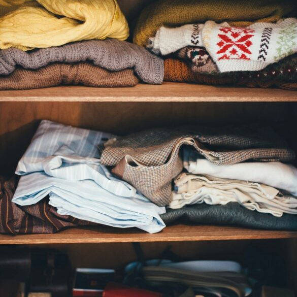piles of clothes declutter before you move