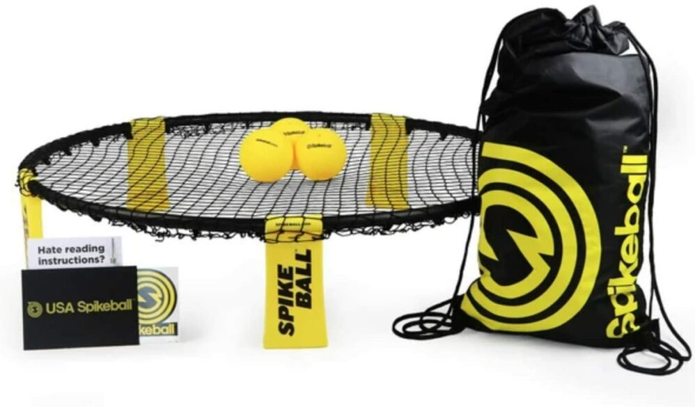 Game of spikeball set up with carrying case. family reunion games