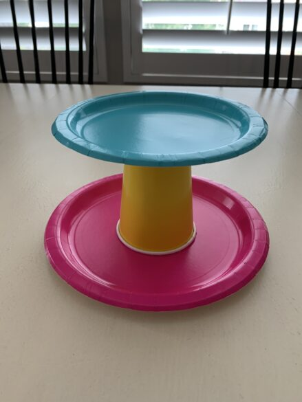 Tiered tray made out of paper plates and a paper cup.