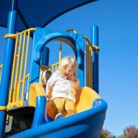 toddler on slide