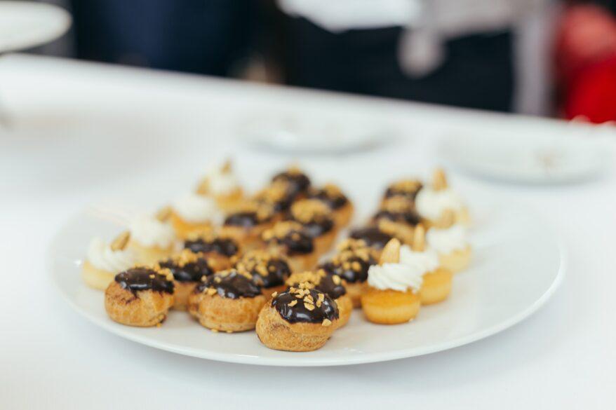 Plate of mini cream puffs.