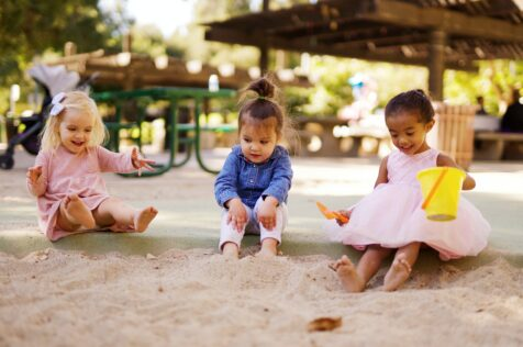 toddlers in sand box activities for 2-year-olds