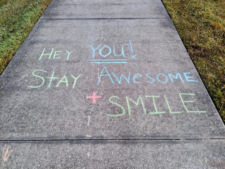 A kind message in sidewalk chalk.